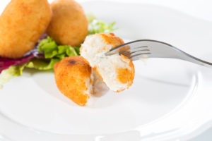 Delicious homemade croquettes on your plate with salad